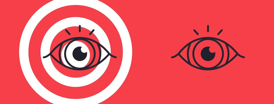 Two black and white eyes on a red background, with one eye having a target over it.