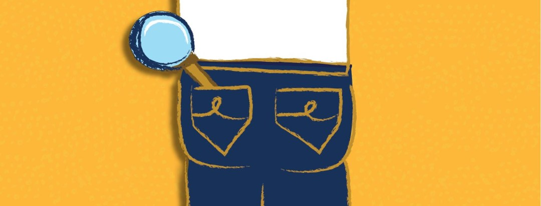 The back of a person's jeans with a magnifying glass hanging out of one pocket.
