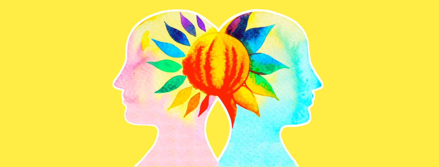 Two people standing back to back with a flower blooming between their heads.