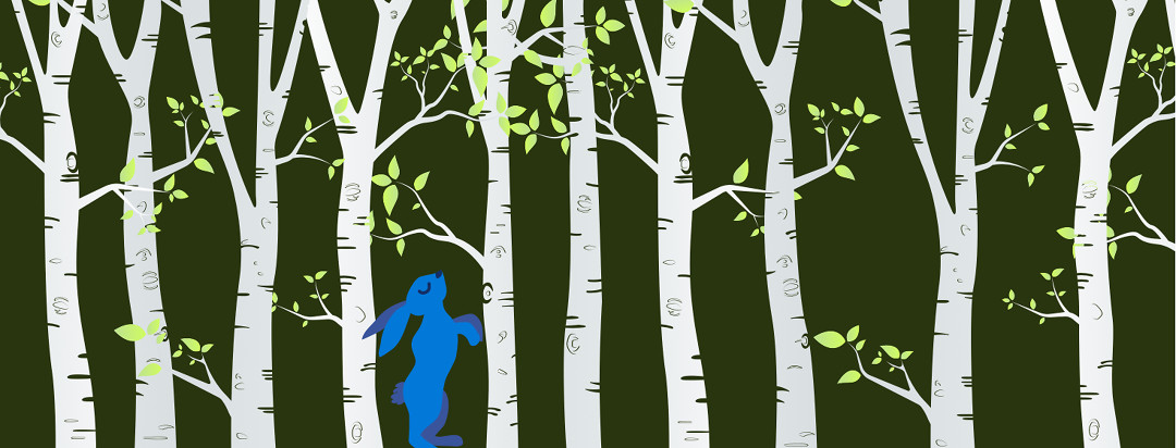A birch tree forrest with a bright blue bunny standing in the middle.