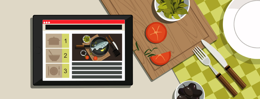 Bird's eye view of a countertop cooking area with a tablet zoomed in on recipe steps.