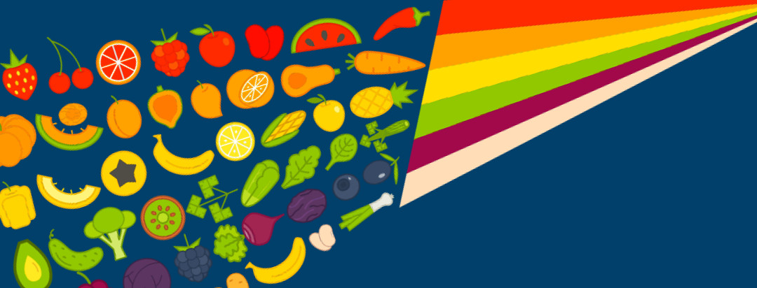 A colorful rainbow with different fruits and veggies spilling out the bottom.