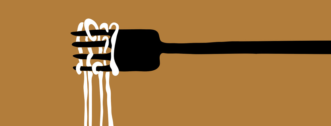 A black fork on a brown background with tangled and twisted white spaghetti hanging off the end.