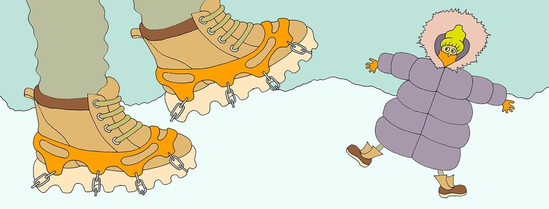 Two giant feet are standing in the snow with snow chains wrapped around the bottoms. There is a tiny person next to the shoe who is all bundled up in a giant puffy coat.