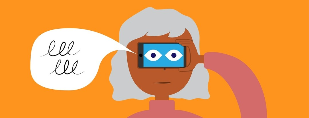 A woman holding a phone up to her eyes and it saying what it sees