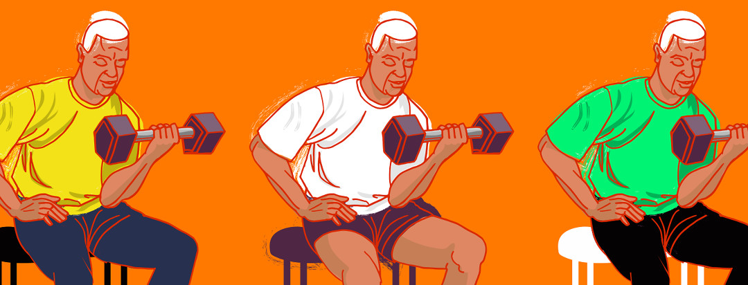 An older man with white hair and trim muscles, using weights to do bicep curls exercise from a chair.