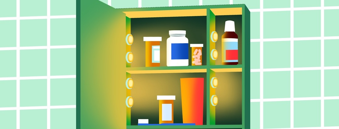 An open medicine cabinet shows the contents illuminated by small lights on the sides of the shelves.