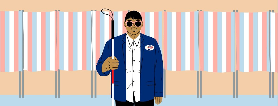"""A person wearing sunglasses and holding a guide stick also has an """"I voted"""" sticker on their lapel and is standing in front of a row of voting booths."""