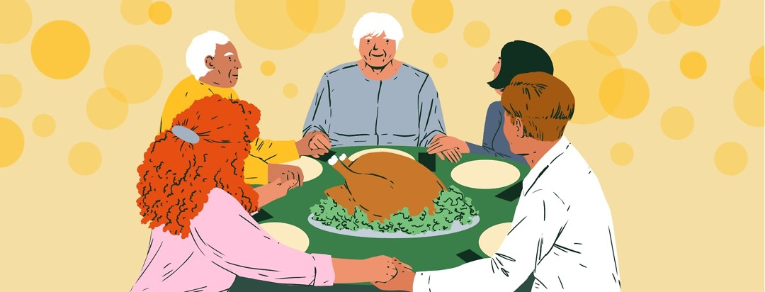 A family smiles and holds hands around a Thanksgiving turkey at a table set for dinner.