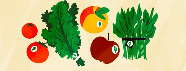 A variety of fresh produce with organic stickers.