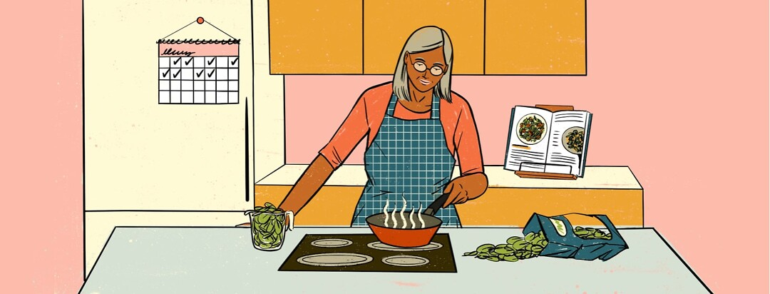 alt=a woman cooks spinach on a stove. A cookbook showing recipes is open behind her. Spinach spills out of a bag and is measured into a cup beside her.