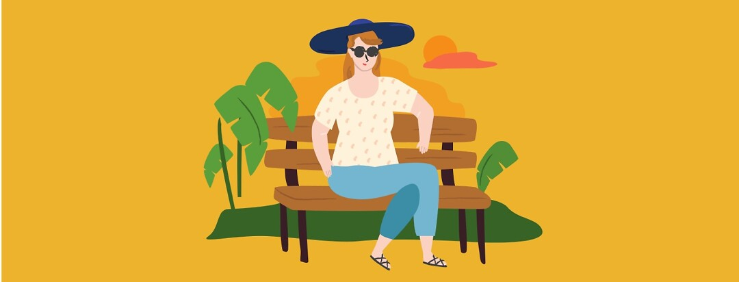 Woman sitting outside on a bench, surrounded by plants, with a sunhat on.