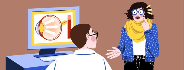 alt=A frightened woman pointing at her eye and talking to a doctor sitting in front of a computer showing an anatomical eye.