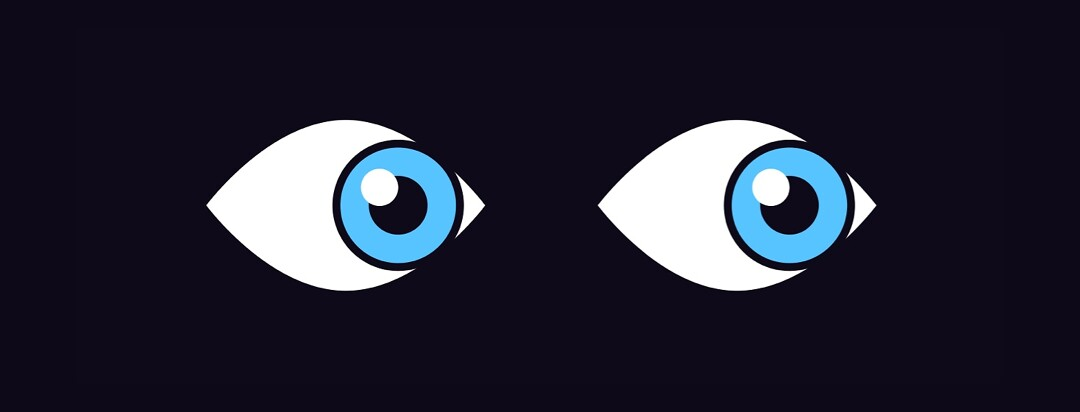 A pair of eyes in the dark, looking to the side.